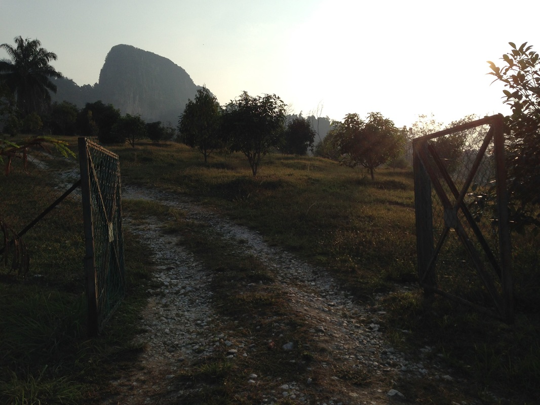 The gate that leads into the farm compound. The gate also frames the peak of Tabur Extreme very nicely in this picture