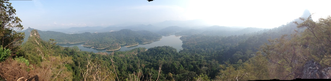 180 degree panorama taken from the top of Tabur Far East peak #2 (highest). On the left are the peaks of Tabur West (far away) and Tabur East. In front are the Klang Gates Reservoir. On the right is the peak of Tabur Extreme. The highlands of the Titiwangsa are not clearly visible due to the hazy conditions