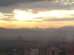 Long distance view of Gunung Besar Hantu from Kuala Lumpur. It's the tallest peak in the centre of the picture