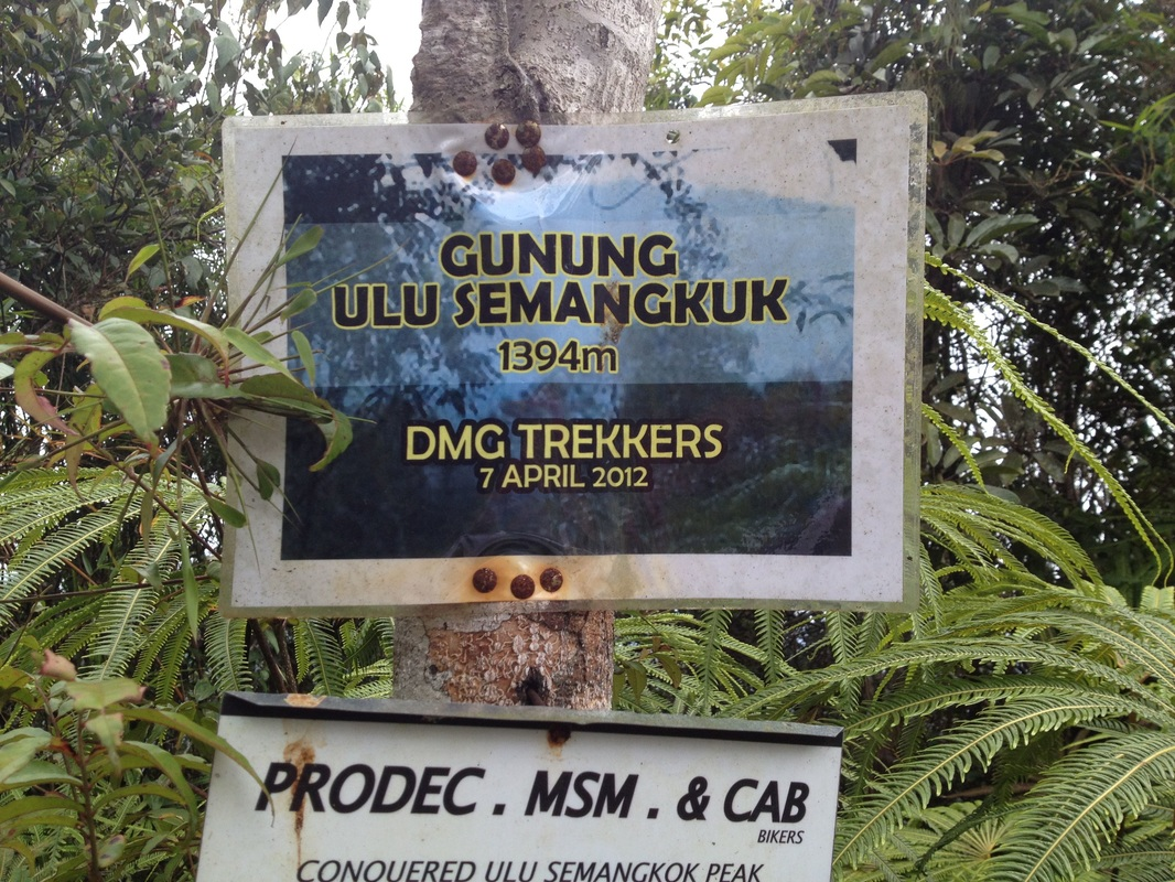 The laminated paper signboard at the peak of Gunung Ulu Semangkok